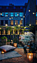 Scandinavian balcony by night, lit with stringlights and candles.