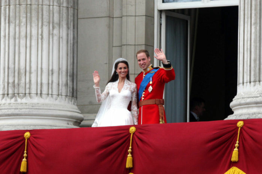 Duke and Duchess of Cambridge appear for the crowds on the balcony of Buckingham Palace after their wedding.