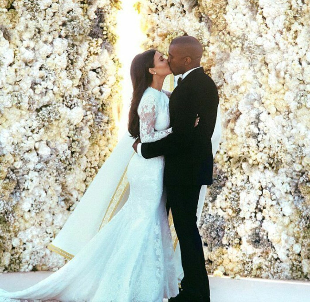 Kim Kardashian and Kanye West are seen kissing on their wedding day just moments after saying 'I do' at Forte di Belvedere in Florence, Italy -2014 REF NO : 74018 FOR EDITORIAL USE ONLY Scope Features Agency does not claim any Copyright or License in the attached material. Any downloading fees charged by Scope are for Scope services only, and do not, nor are they intended to, convey to the user any Copyright or License in the material. By publishing this material , the user expressly agrees to indemnify and to hold Scope harmless from any claims, demands, or causes of action arising out of or connected in any way with user's publication of the material.
