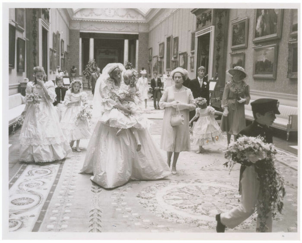 A collection of 12 unpublished behind the scenes photographs from the wedding of Princess Diana and Prince Charles are set to sell for *** when they go under the hammer. The pictures were taken at their reception at Buckingham Palace on July 29 1981 after their wedding ceremony at St. Paul's Cathedral. They originate from the collection of a an assistant to photographer Patrick Lichfield and include seven black and white pictures and five color, as well as the assistant's access pass to the palace. Six of the larger photos depict Princess Diana wearing her gorgeous wedding dress with members of her family and wedding party, including Queen Elizabeth, Prince Charles, Princess Ann, Princess Margaret, and Prince Andrew. Three show Princess Diana holding the five-year-old Clementine Hambro, her youngest bridesmaid; one shows her setting Clementine down; and another shows her smiling as Prince Andrew leans over to talk to Clementine. Queen Elizabeth is clearly visible walking alongside Princess Diana in four of the images, and the Queen Mother is seen in two. Prince Charles is also in two of these photographs. The last of the photos is the most striking of all, depicting Princess Diana and Prince Charles from behind on the famous balcony overlooking the massive crowds gathered on the Mall in front of Buckingham Palace. The lot will be sold by RR Auction in Cambridge, MA, on September 24 2015. Ref: SPL1098968 100815 Picture by: RR Auction / Splash News Splash News and Pictures Los Angeles: 310-821-2666 New York: 212-619-2666 London: 870-934-2666 photodesk@splashnews.com