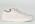 Ljusrosa tygskor med vit snörning. Vit sula och täckt tå. Sneakers från Acne.