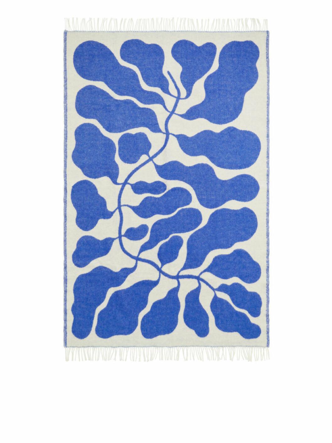 Filt med blått grenmotiv