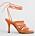 Orange sandalett med hög klack och flera tunna, flätade remmar över foten och långa remmar som ska knytas runt vristen. Sandaletter från Atp Atelier.