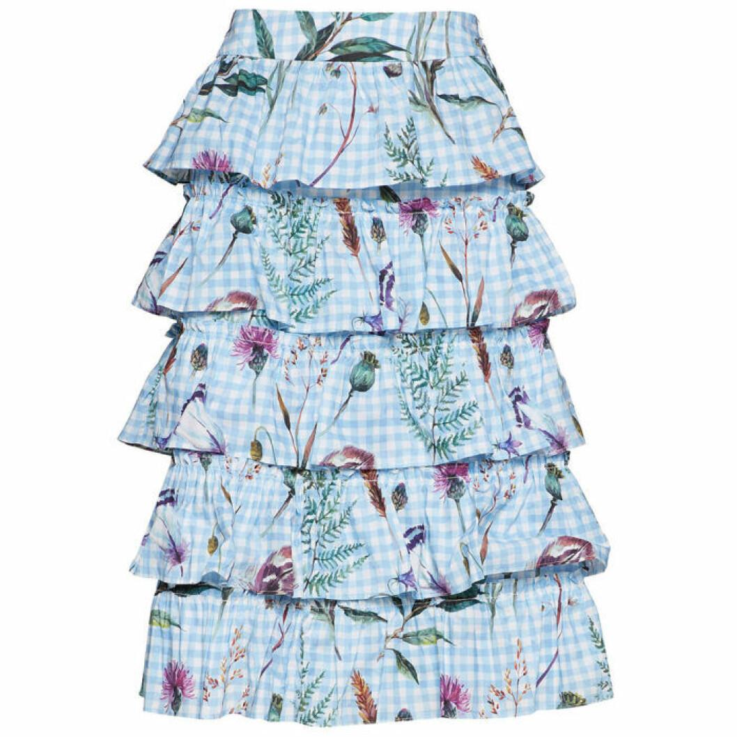 Blå kjol med blommor och volanger från By Malina