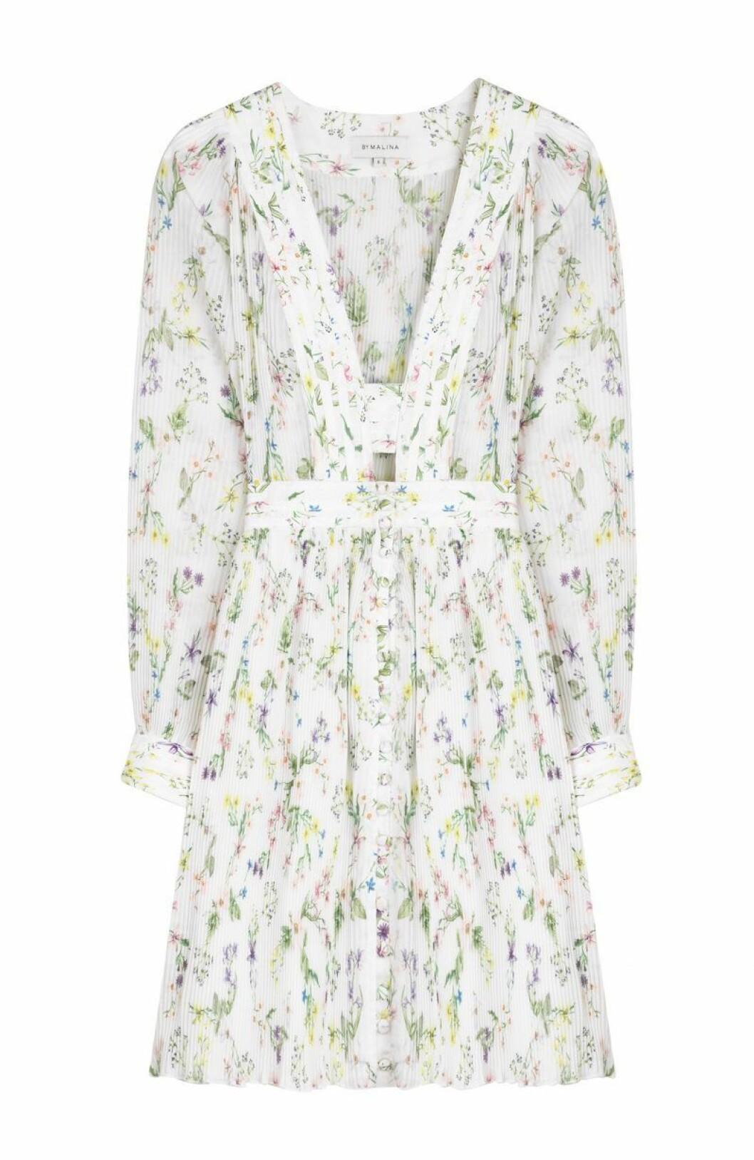 Vit blommig klänning med lång ärm från By Malina