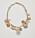 Halsband med gulfärgad kedja och bollar och kulor i olika storlekar och material. bollarna är guldfärgade, beige och ljusrosa. Halsband från Cos.
