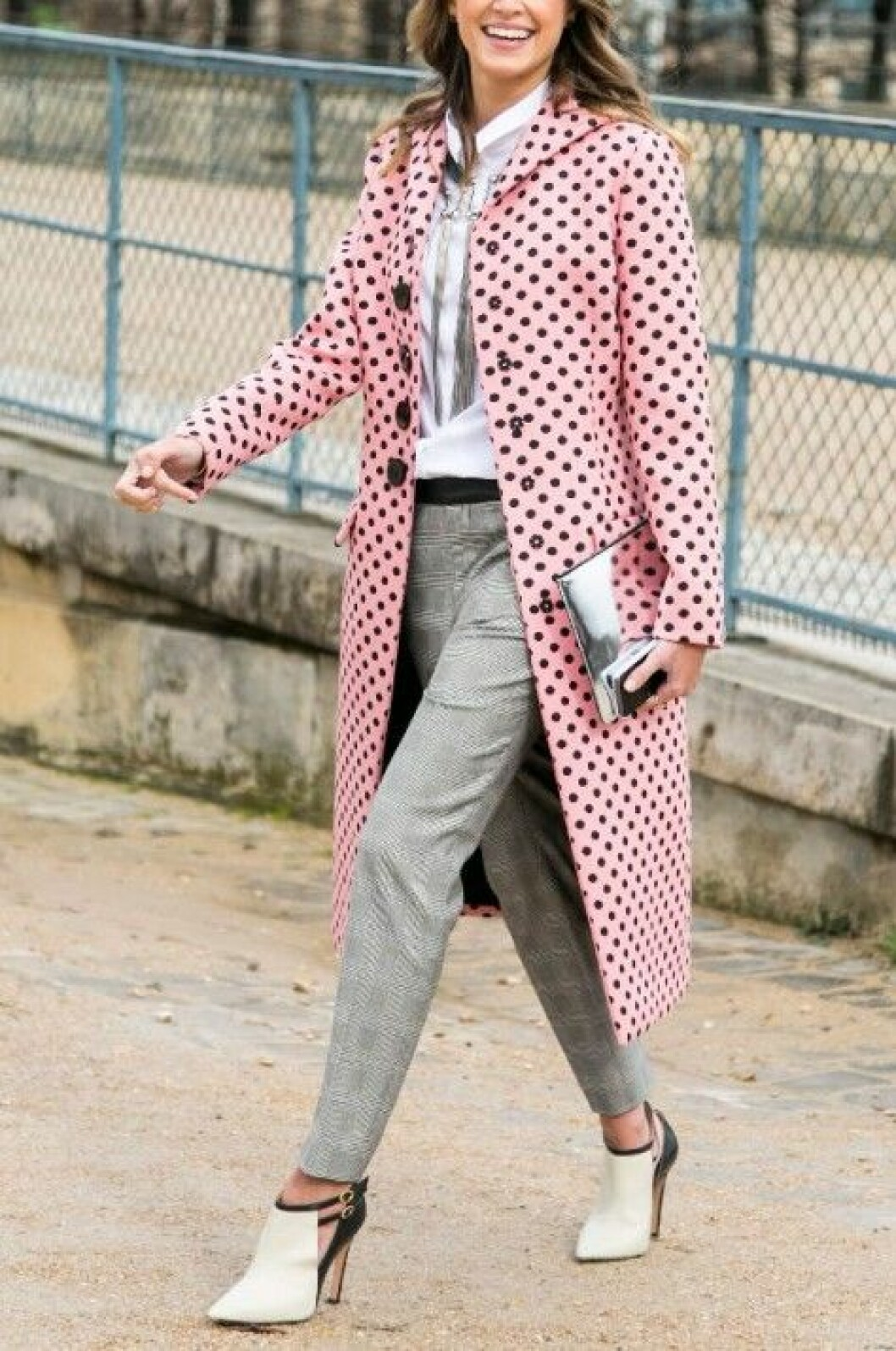 Dotted coat on a woman. Street fashion photo