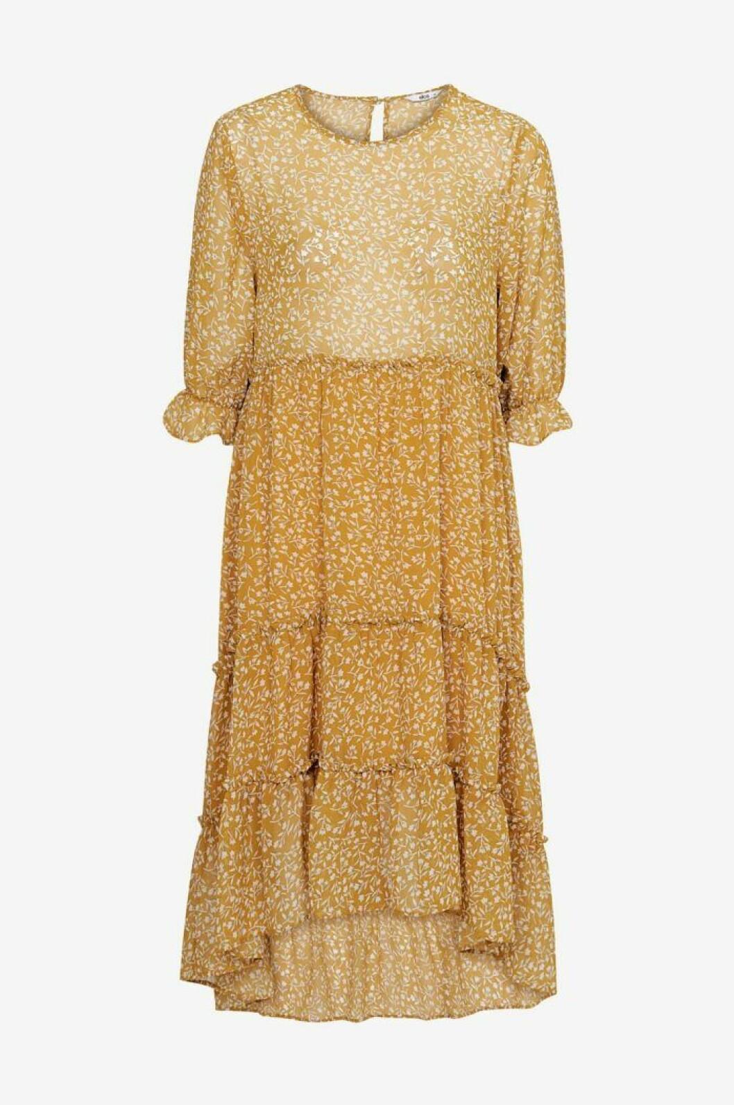 Gul klänning med v volanger