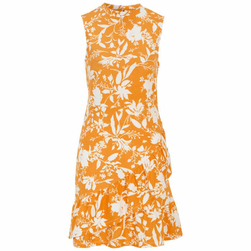 Gul/orange klänning med vita blommor och blad