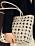 Beige väska i shoppermodell. Flätad och hålmönstrad. Väska från H&M.