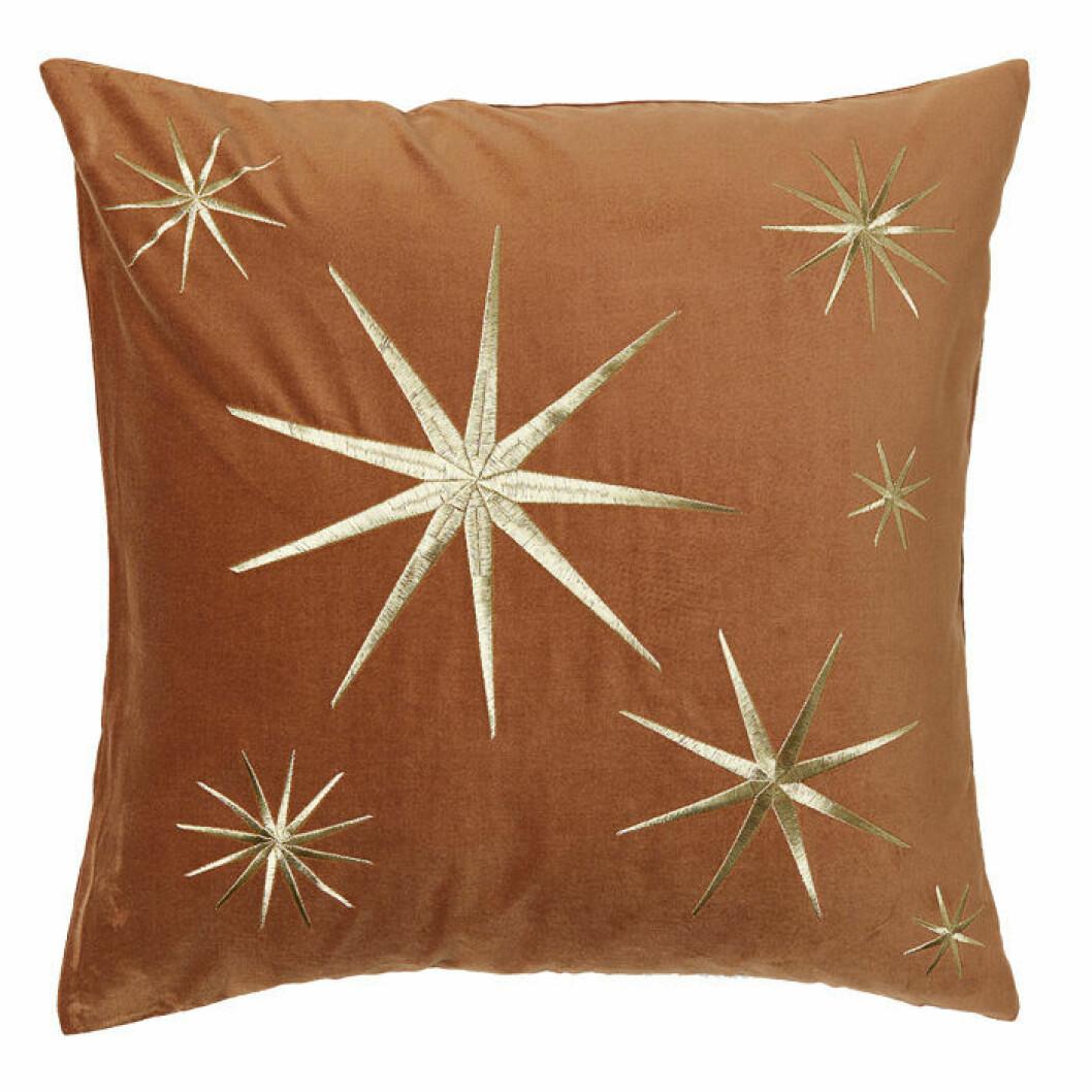 sammetskudde med stjärnor i guld
