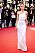 Izabel Goulart i tajt, vit klänning med cut out i midjan och one shouder.