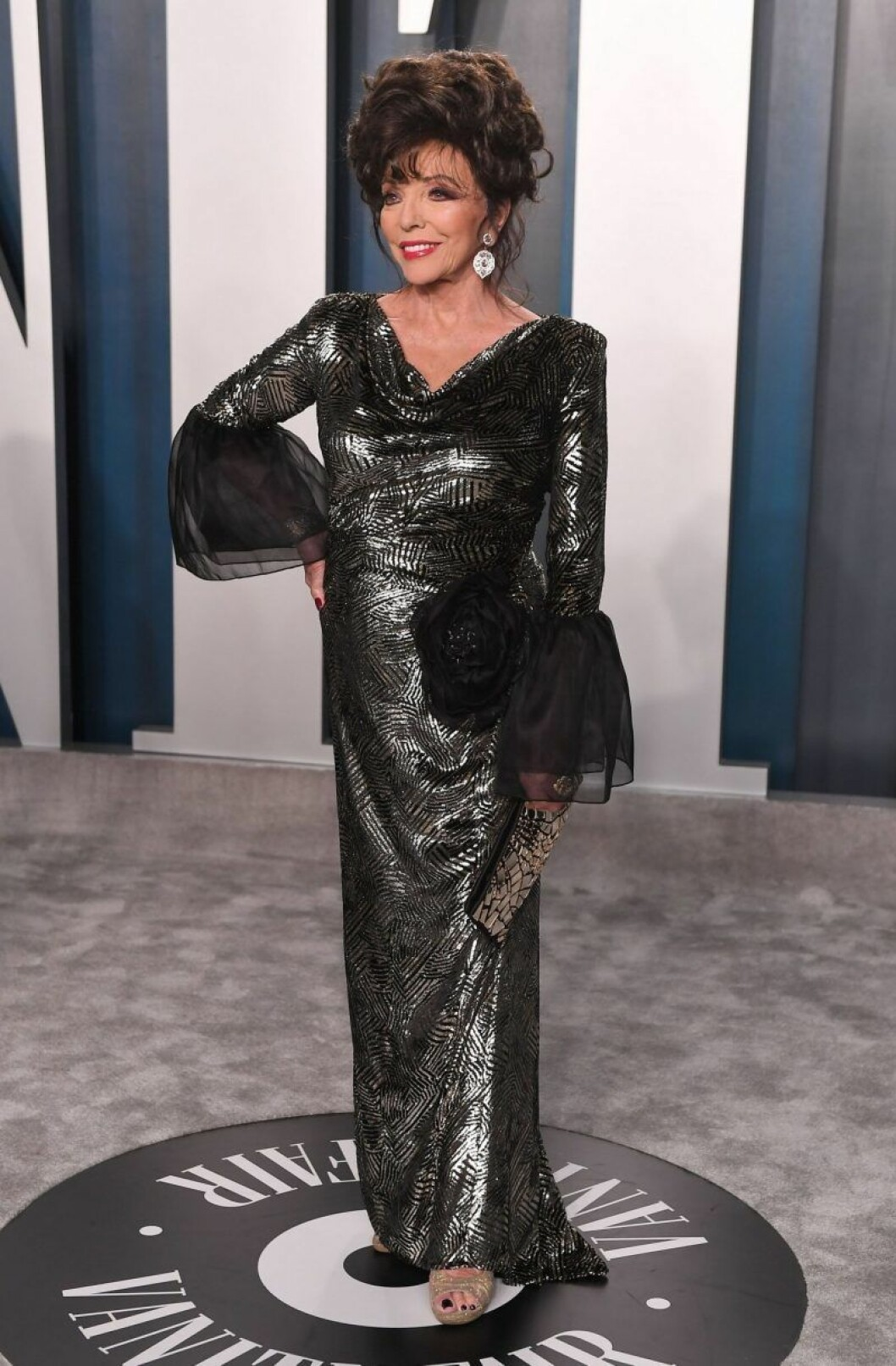 Joan Collins i klänning