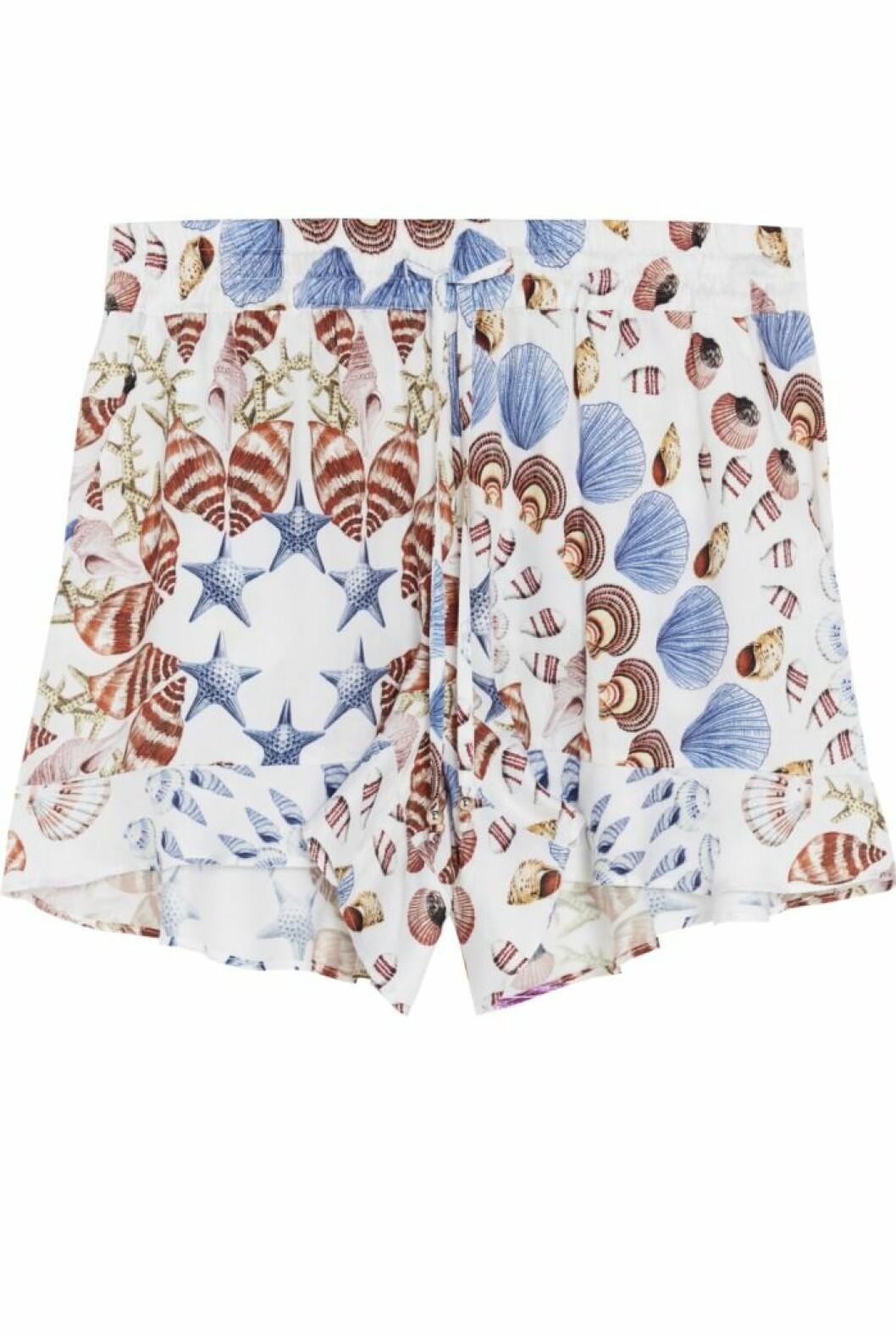 Ljusa shorts med snäckskalsmönster By malina för Lindex