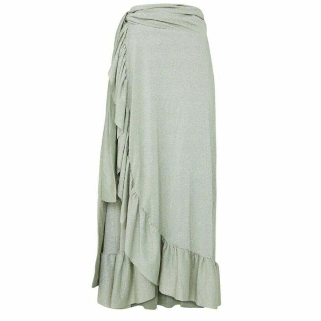 Grön kjol i omlott
