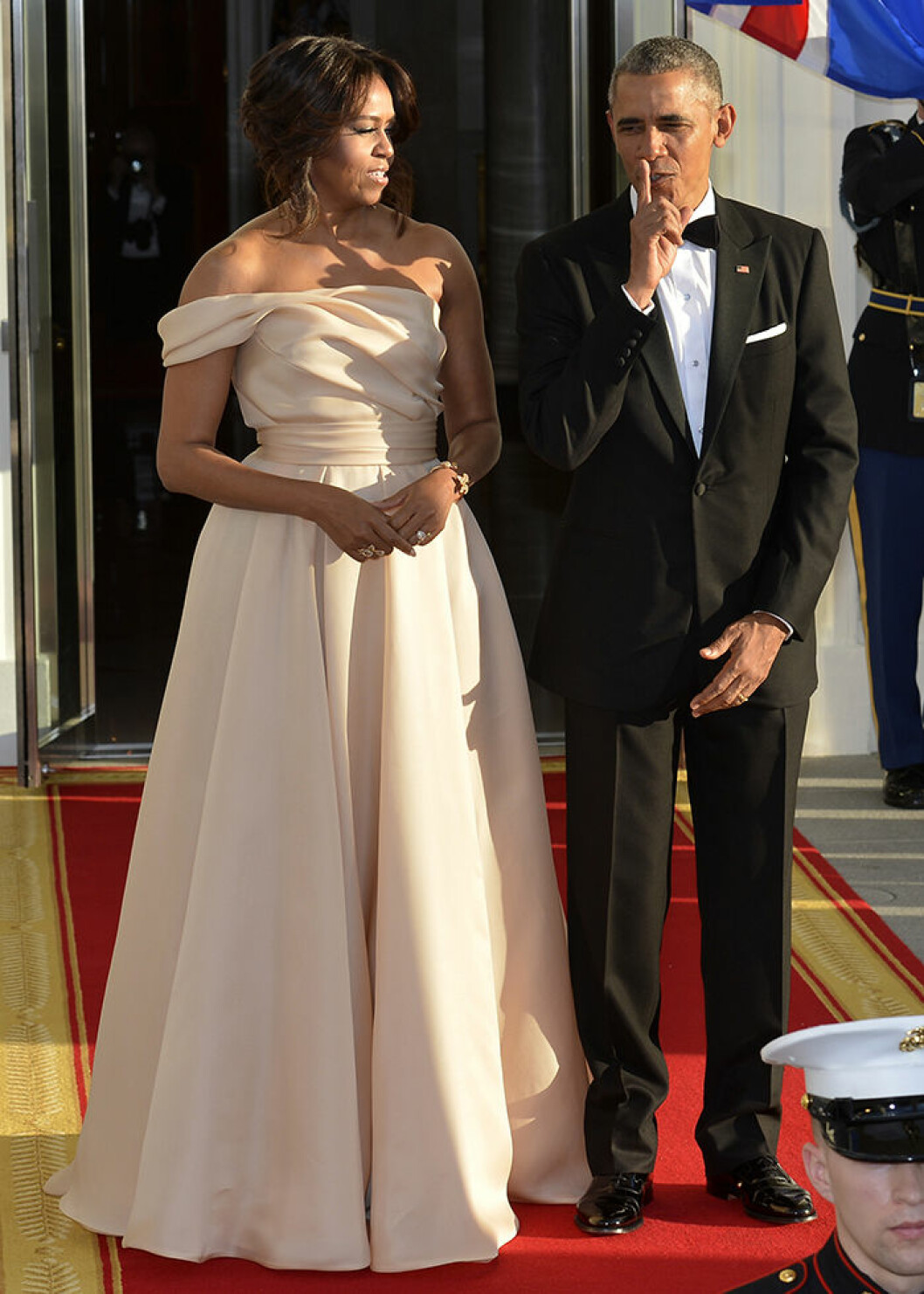 U.S. President Barack Obama gestures a whisper as he and First Lady Michelle Obama await the arrival of leaders from the five Nordic countries for a State Dinner WEARING NAEEM KHAN
