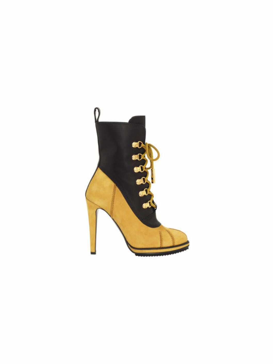 Högklackad hög känga i svart och guld Moschino [tv] H&M