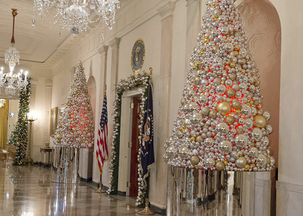 "The 2016 White House Christmas decorations are previewed for the press at the White House in Washington, DC on Tuesday, November 29, 2016. Pictured are Christmas decorations in the Grand Foyer looking towards the East Room. The first lady's office released the following statement to describe those decorations, ""This year∑s holiday theme, 'The Gift of the Holidays,' reflects on not only the joy of giving and receiving, but also the true gifts of life, such as service, friends and family, education, and good health, as we celebrate the holiday season."" Credit: Ron Sachs / CNP - NO WIRE SERVICE - Photo: Ron Sachs/Consolidated/dpa (c) DPA / IBL BildbyrÂ"
