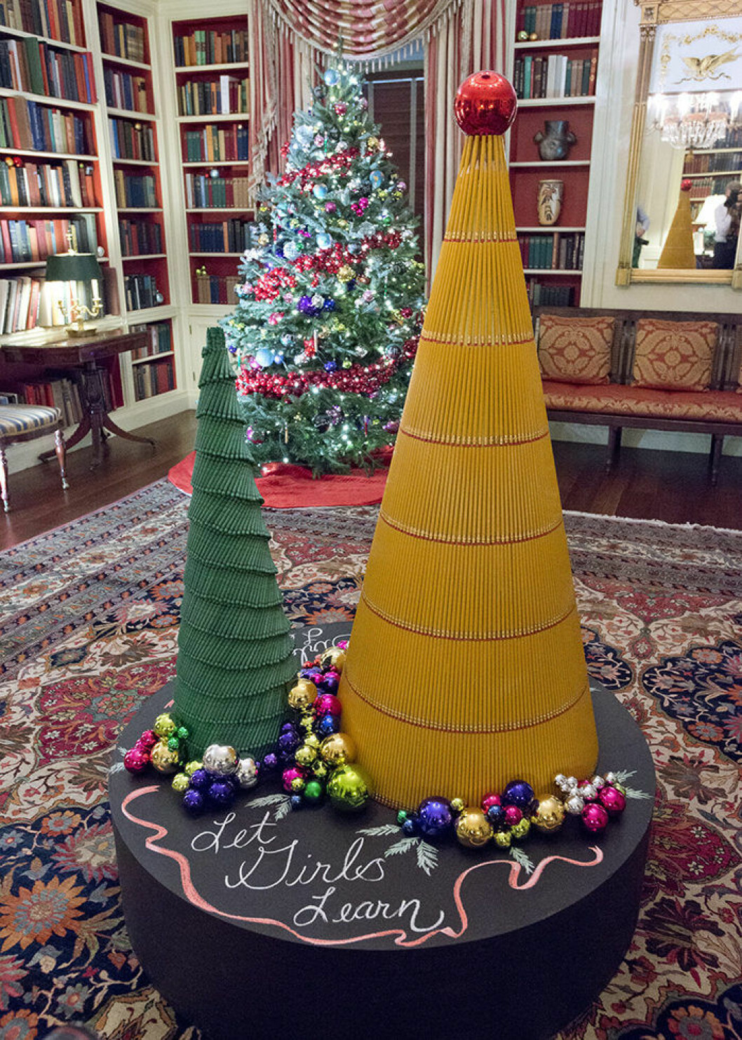 "The 2016 White House Christmas decorations are previewed for the press at the White House in Washington, DC on Tuesday, November 29, 2016. The Gift of Education is brought to life in The Library, highlighting the more than 2,700 books housed there. Rulers will rim the base of the holiday trees while crayons and pencils create additional standalone trees. The colorful ornaments on display will spell out the word ?girls? in 12 different languages, paying homage to the First Lady?s Let Girls Learn initiative. The first lady's office released the following statement to describe those decorations, ""This year?s holiday theme, 'The Gift of the Holidays,' reflects on not only the joy of giving and receiving, but also the true gifts of life, such as service, friends and family, education, and good health, as we celebrate the holiday season."" Credit: Ron Sachs / CNP - NO WIRE SERVICE - Photo: Ron Sachs/Consolidated/dpa (c) DPA / IBL BildbyrÂ"