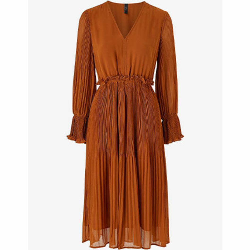 Orange färg klänning med volang