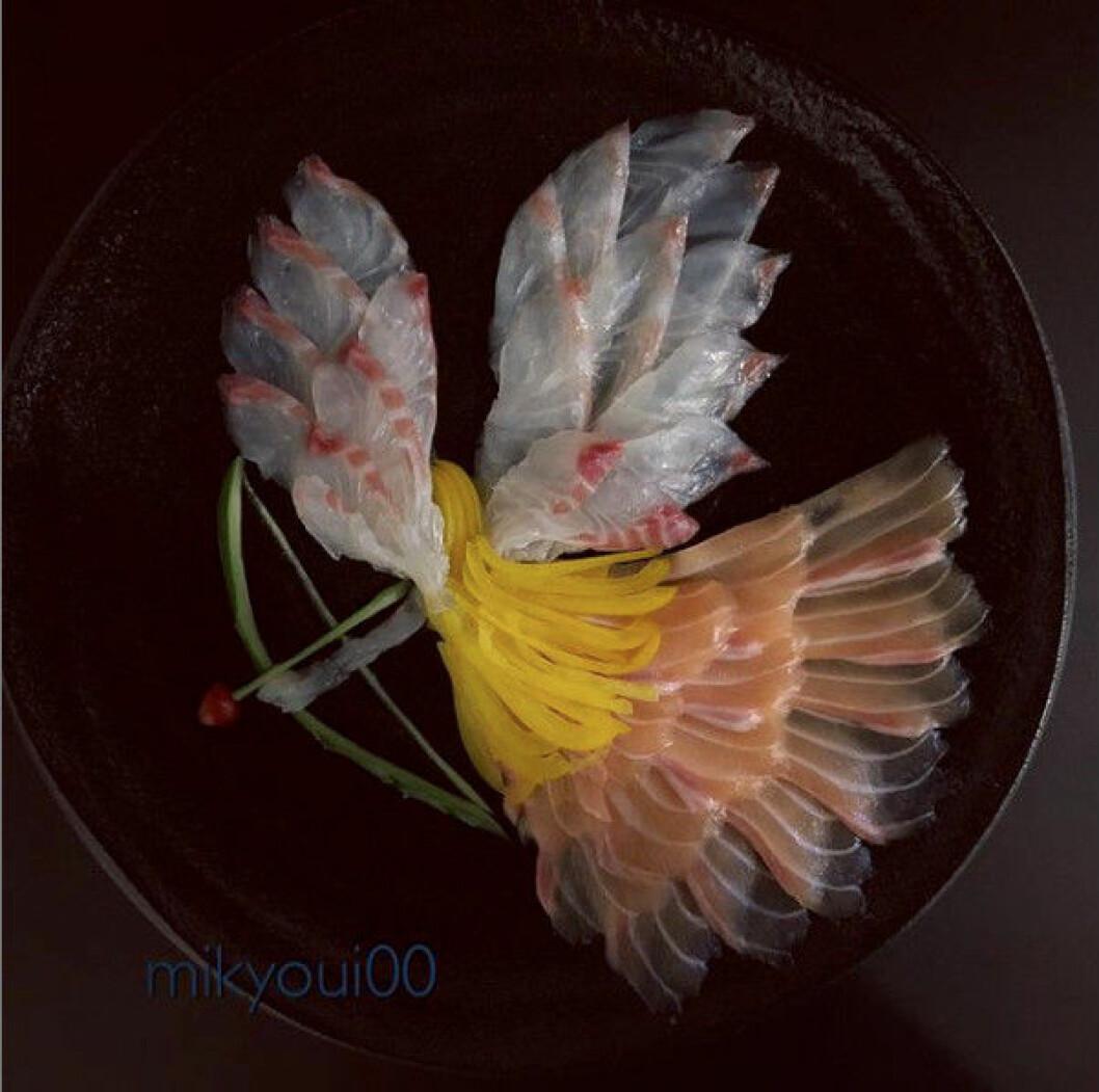 Sashimikonst i form av en ängel med pilbåge.