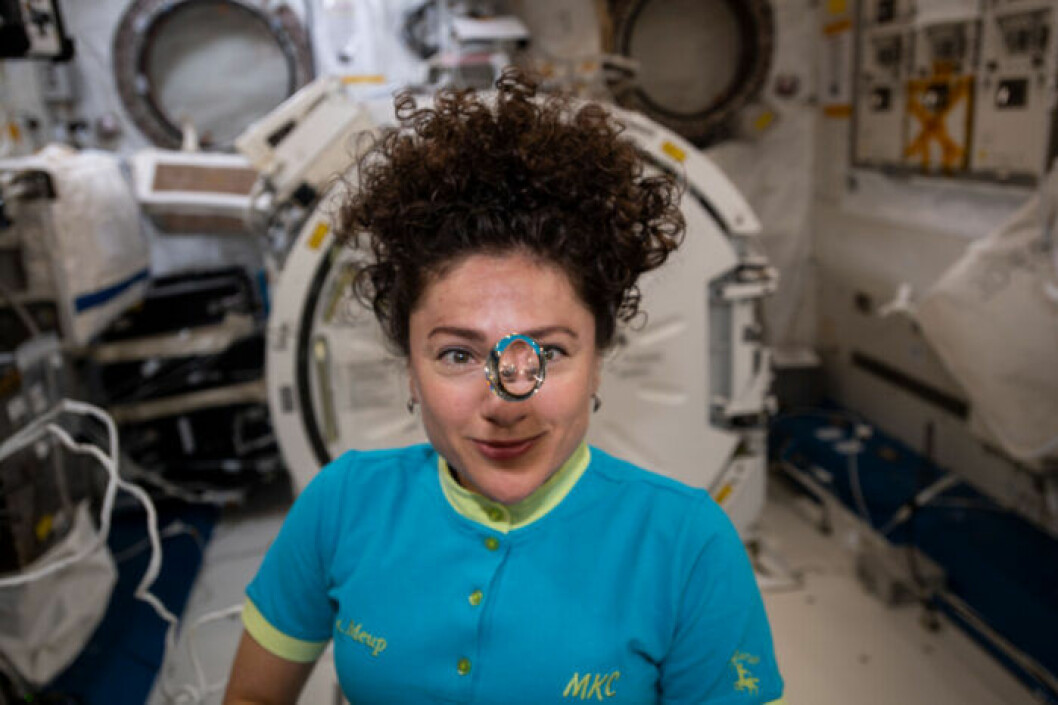 Den amerikansk-svenska astronauten Jessica Meir i ett rymdskepp.