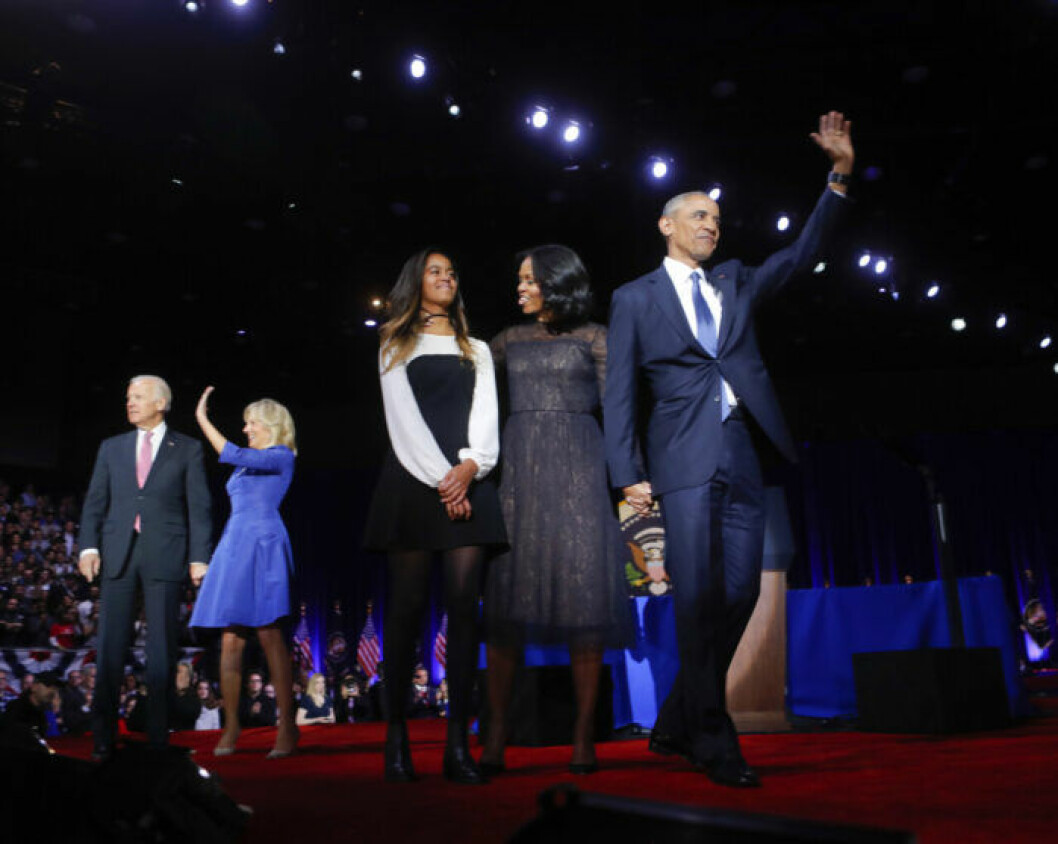 President Barack Obama on stage with first lady Michelle Obama, daughter Malia, Vice President Joe Biden and his wife Jill Biden