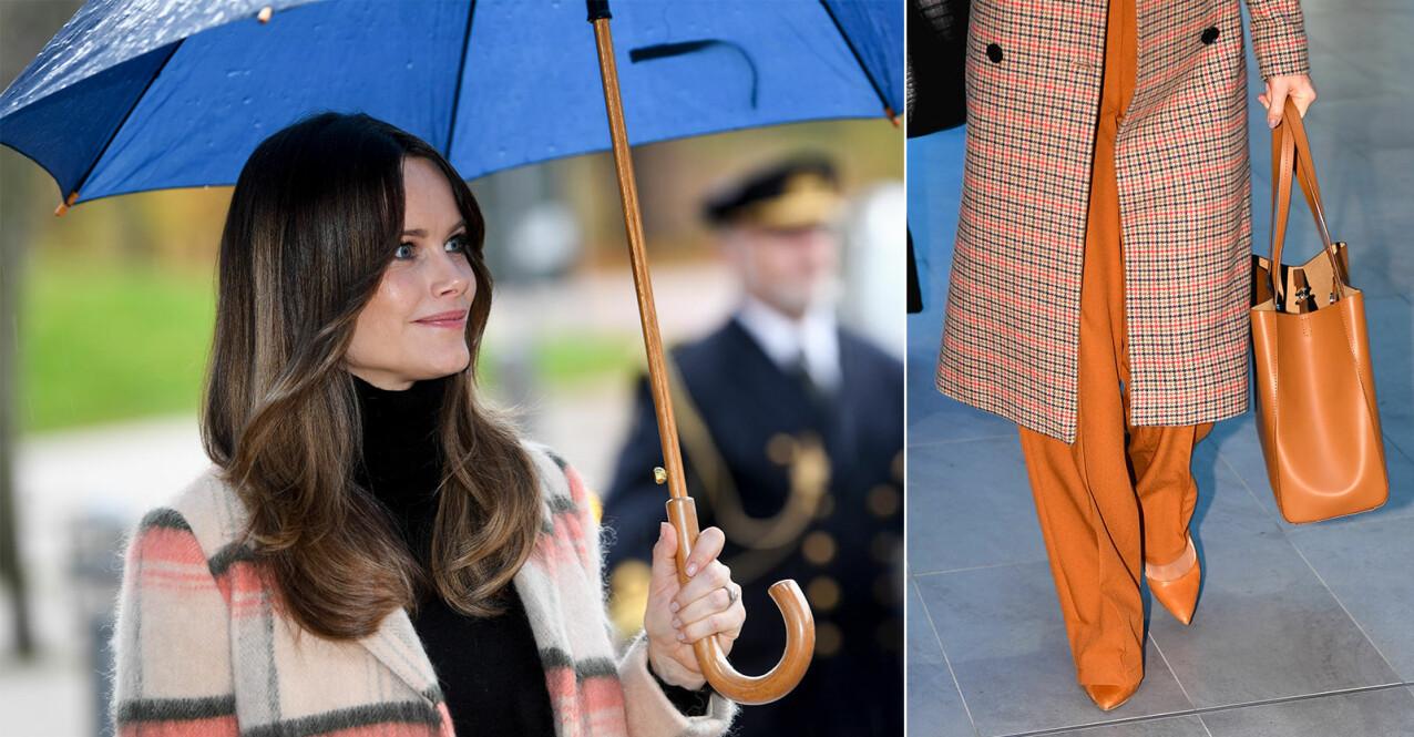 Prinsessan sofia med paraply och en snygg beige väska