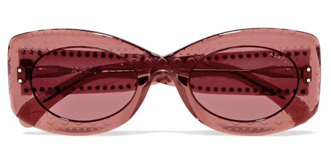 Rosa solglasögon i hård plast
