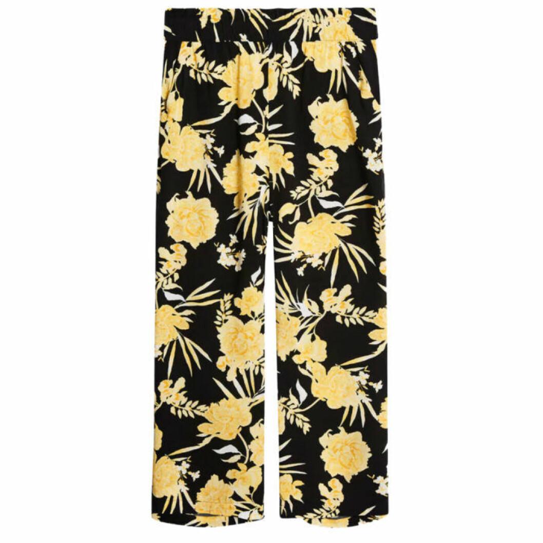 Svarta byxor med gula blommor