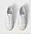 Vita sneakers i skinn med mockadetaljer i off-white. Sneakers från Totême.