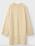 Oversizad, gul-beige, lång stickad tröja med rundad hals och långa slitsar i sidorna. Tröja från Toteme.