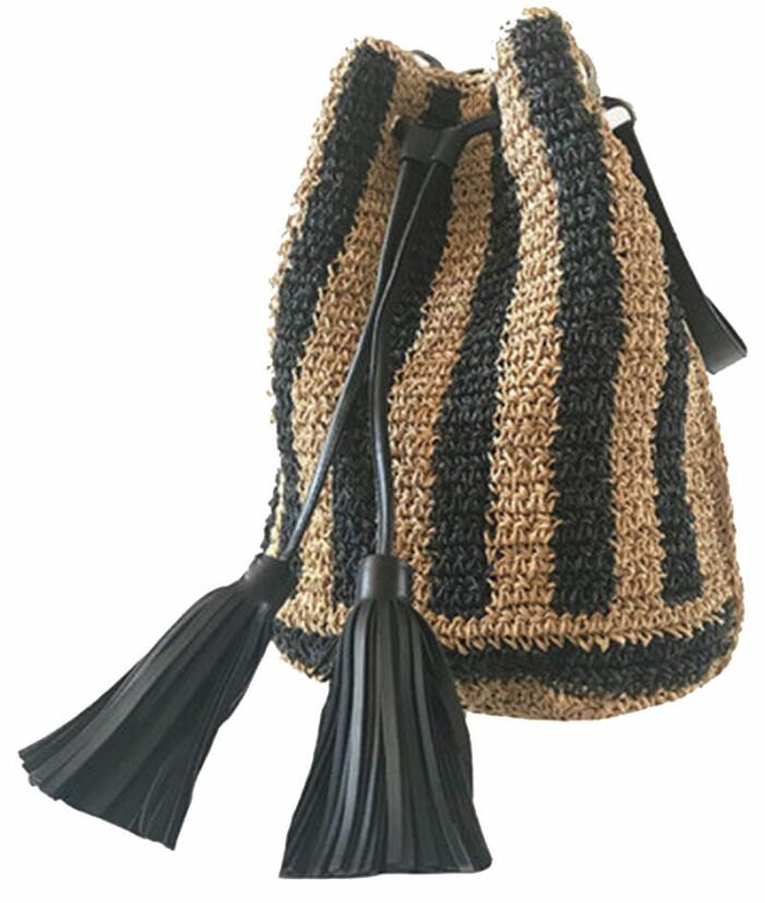 Snygg handväska med tofsar